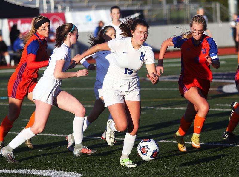 TIMES PHOTO: DAN BROOD - Valley Catholic senior Chloe Brock (15) looks to quickly get the ball up field during Saturday's state championship match.