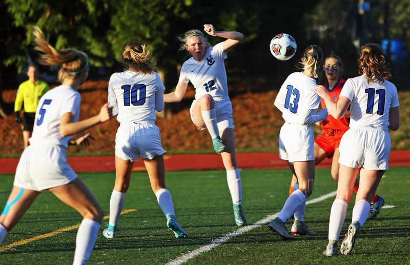 TIMES PHOTO: DAN BROOD - Valley Catholic's (from left) Kate MacNaughton, Sarah Jones, Katelyn Snook, Johanna Filip and Riley McGee surround the ball during Saturday's state championship match.