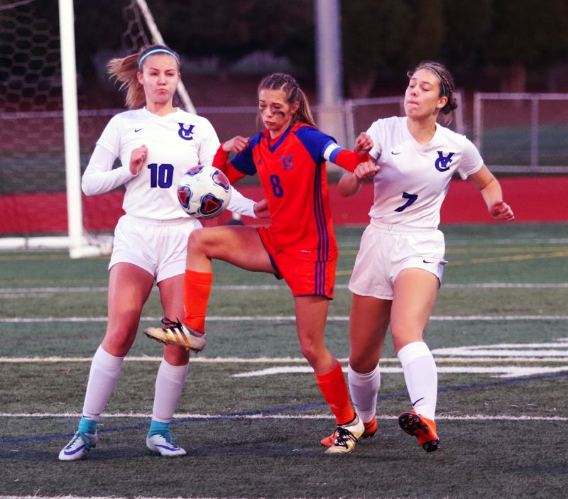 TIMES PHOTO: DAN BROOD - Valley Catholic senior Sarah Jones (10) and senior Hannah LaVeine battle Hidden Valley senior Nyah Kendall for the ball in Saturday's state title contest.