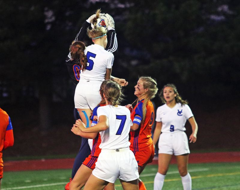 TIMES PHOTO: DAN BROOD - Hidden Valley goalie Kaiah Fisher grabs the ball right before Valley Catholic senior Kate MacNaughton can get her head on it off a corner kick.
