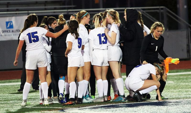 TIMES PHOTO: DAN BROOD - The Valiants gathered after the final whistle blew during Saturday's Class 4A state championship match.