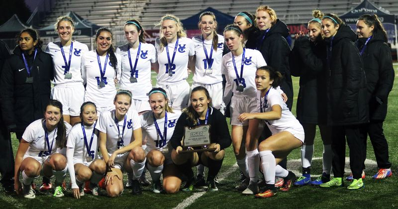 TIMES PHOTO: DAN BROOD - The Valley Catholic High School girls soccer team received the Class 4A second place trophy following Saturday's match.