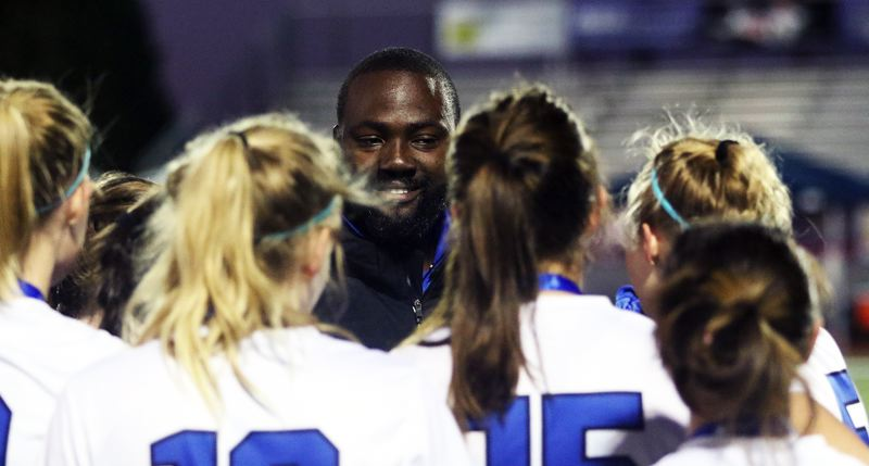 TIMES PHOTO: DAN BROOD - Valley Catholic coach Kibwe Cuffie talks to his team following Saturday's Class 4A girls soccer state championship match.