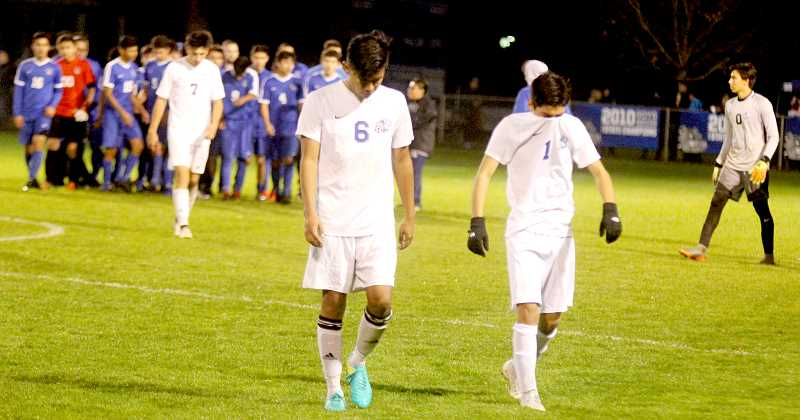 STEELE HAUGEN - Senior Cesar Aguirre (left) and junior Franklin Pineda show their dissapointment at the end of their semifinals match. The Buffalos lost to Woodburn 6-0 and Woodburn would beat North Marion 2-0 in the 4A championship game Nov. 10.
