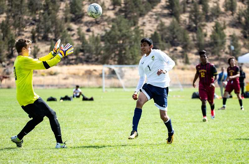 LON AUSTIN - Redmond High School goalkeeper Hunter Holmes, left, plays against Crook County High School on Sept. 30, 2017. He suffered a concussion a few weeks later during a game. He took his own life in mid-December.