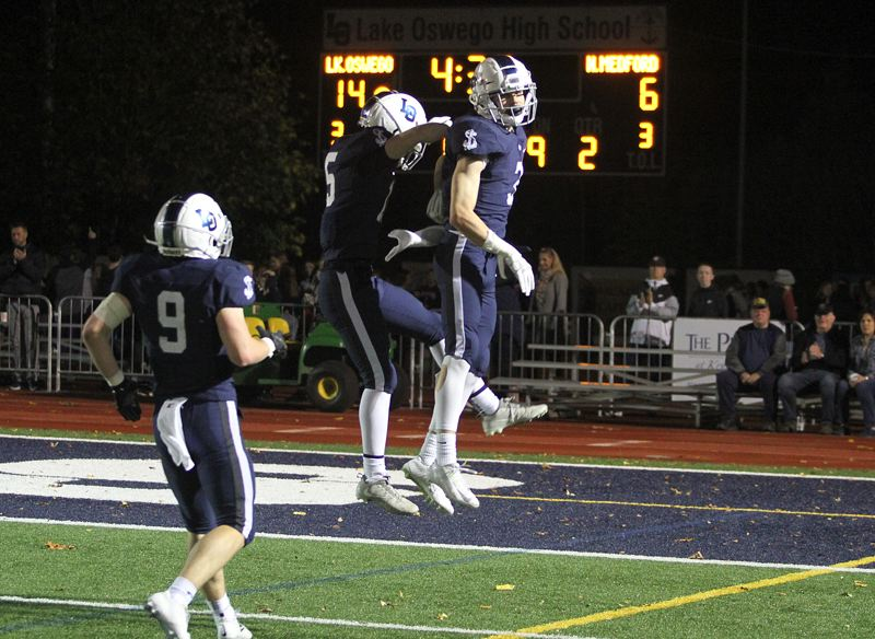 REVIEW FILE PHOTO - Lake Oswego's Joe Hutson (right) and Matt Sebolsky - here catching some air in a game earlier this season - are all-league cornerbacks who lead the Laker defense in preparation for this week's game against Central Catholic.