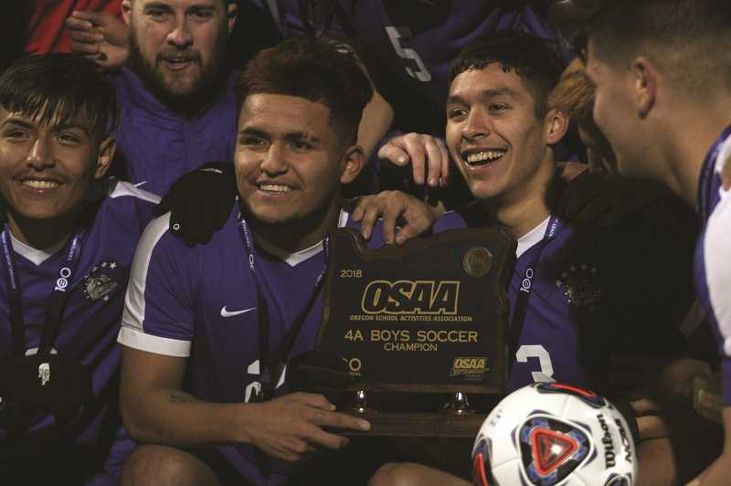 PHIL HAWKINS - Woodburn's Salvador Perez, Jesus Rodriguez and Edwin Silva are three of 11 seniors who finished their boys soccer careers with the Bulldogs by bringing home the program's sixth state title in school history and third consecutive championship.