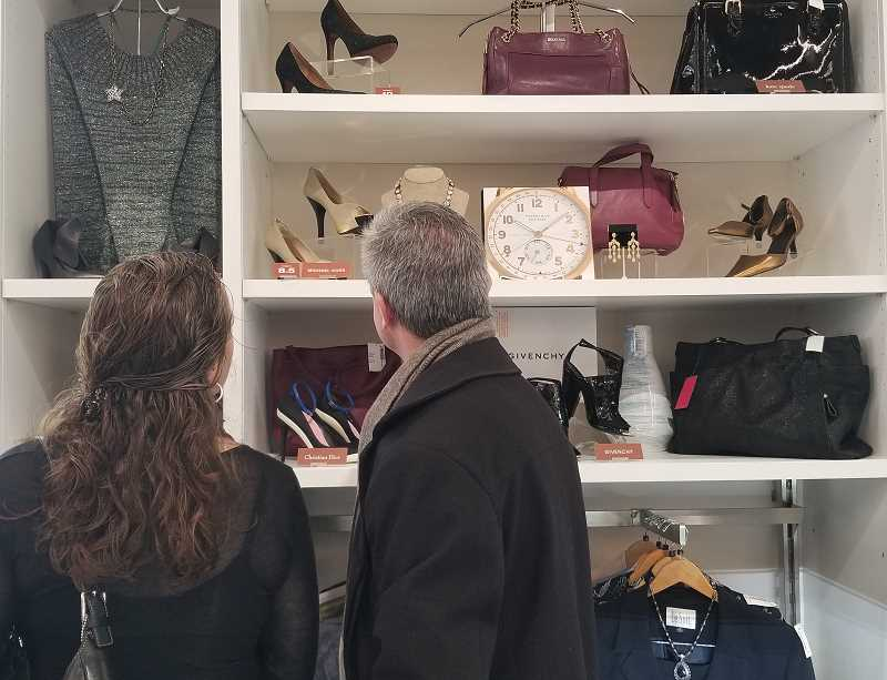REVIEW PHOTO: GARY M. STEIN - Shoppers peruse some the hand-selected merchandise at Goodwill Industries of the Columbia Willamette's new boutique in Lake Oswego. The shop's inventory will rotate to other stores about every two weeks.