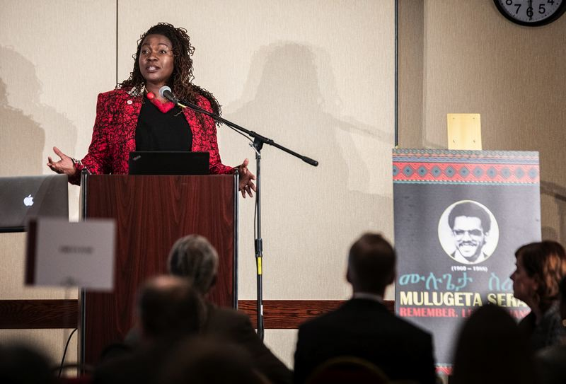 PORTLAND TRIBUNE: JONATHAN HOUSE - Nkenge Harmon Johnson, president and CEO of the Urban League of Portland, gives opening comments during the Mulugeta Seraw Commemoration Conference.