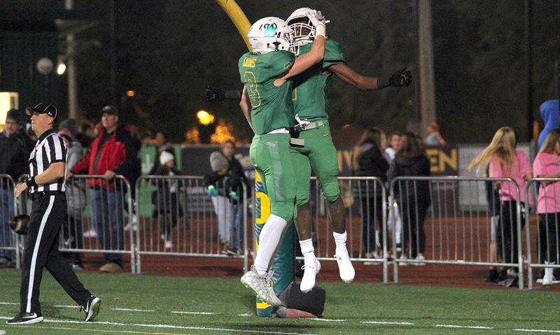 TIDINGS PHOTO: MILES VANCE - West Linn's Casey Tawa (left) and Dawson Jolley (shown earlier this year) are hoping to have more reasons to celebrate on Friday when they play at Sheldon in the state quarterfinals.