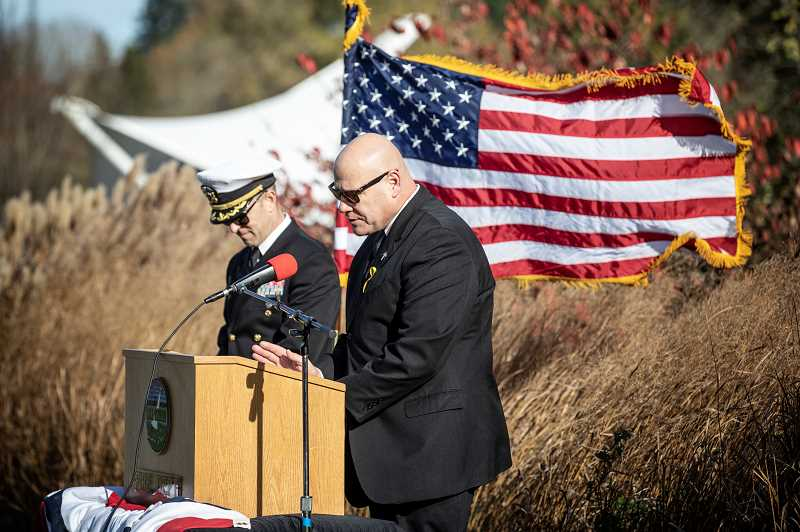 REVIEW PHOTO: JONATHAN HOUSE - Lake Oswego Police Chaplain Mike Vermace gives a blessing for the new Veterans Memorial at Foothills Park.