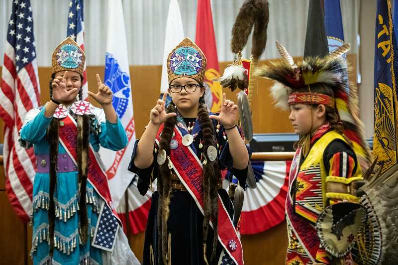 REVIEW PHOTO: JONATHAN HOUSE - Junior Miss Grand Ronde Kaleigha Simi (from left), Senior Miss Grand Ronde Isabelle Grout and Junior Warrior Nacoma Liebelt perform during the Veterans Day program at City Hall.