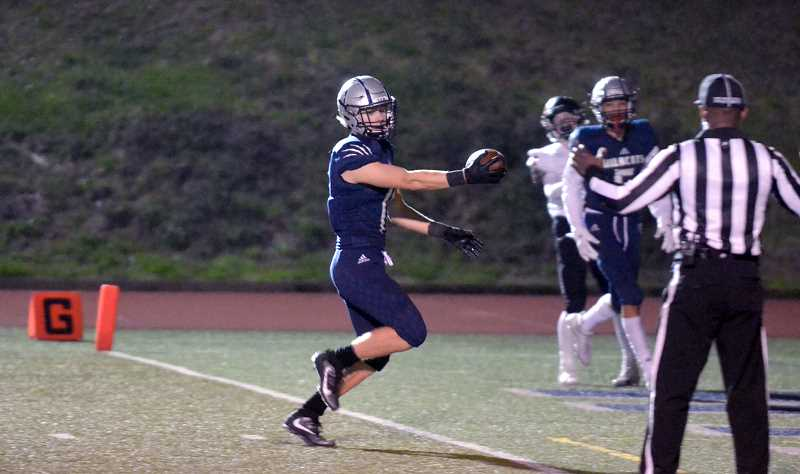 SPOKESMAN PHOTO: TANNER RUSS - Senior Cade Edmondson had two catches and two touchdowns against Crater.