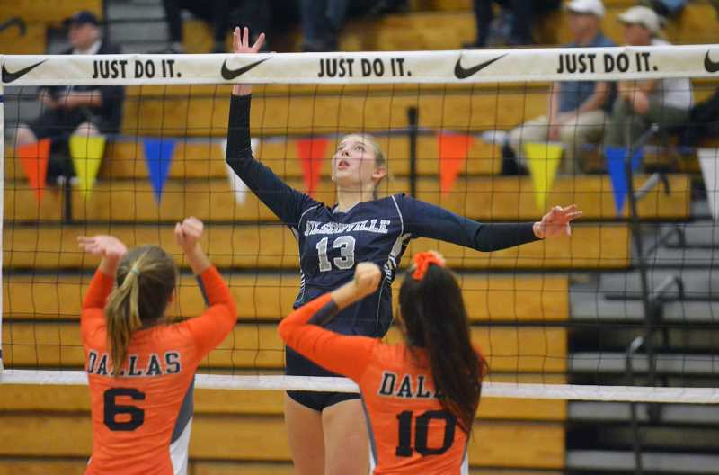 ARCHIVE PHOTO: TANNER RUSS - Junior outside hitter Lindsey Hartford was named Player of the Year for her blocks and kills at the net.