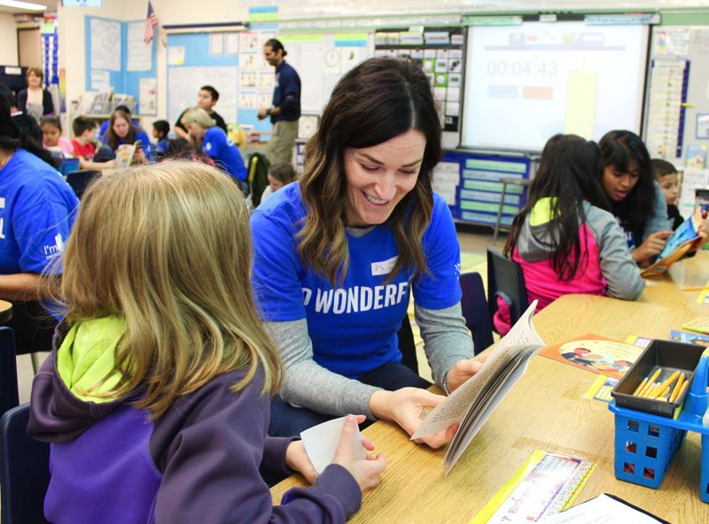 STAFF PHOTO: OLIVIA SINGER - Students at both W.L. Henry Elementary and Brookwood Elementary schools got to read with Intel volunteers last week in Hillsboro as part of the SMART program.