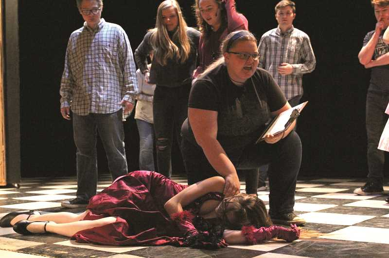 "LINDSAY KEEFER - Actors gather around the leading lady, played by Mary Kaufman, in a show within a show when she collapses near the start of ""Curtains,"" a murder mystery musical comedy being performed by North Marion Players at 7:30 p.m. Friday and Saturday at North Marion High School."