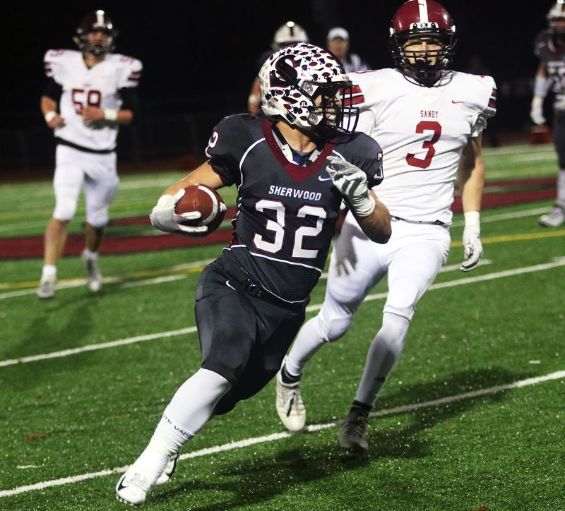 TIMES PHOTO: DAN BROOD - Sherwood senior Ian Stormont, shown here in the playoff win over Sandy, ran for 121 yards and touchdown at Sheldon.