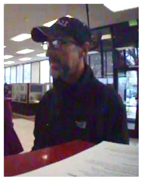 COURTESY OF TIGARD POLICE DEPARTMENT - Police say this man, believed to be in his 50s, robbed a Pacific Highway Key Bank Tuesday.