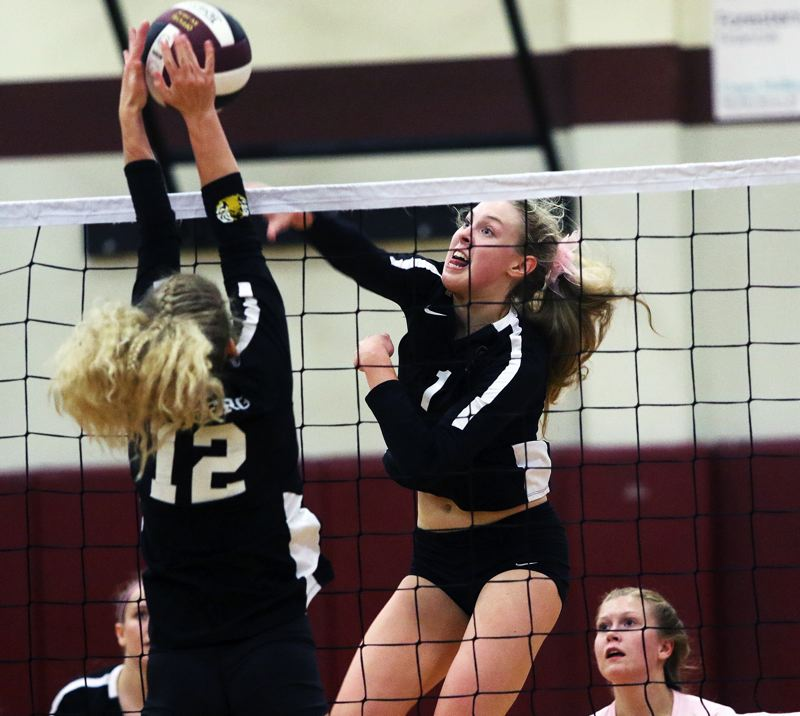 TIMES PHOTO: DAN BROOD - Sherwood High School junior Alli Douglass (right) returned from injury to help the Lady Bowmen reach the state playoffs this year.