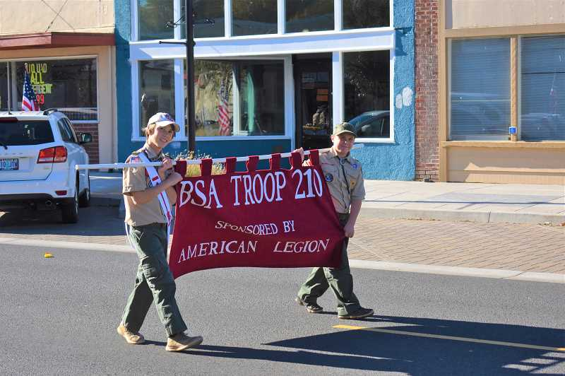 ESTACADA NEWS PHOTO: EMILY LINDSTRAND - Members of Boy Scout Troop 210 smile during Estacadas Veterans Day parade on Sunday, Nov. 11.