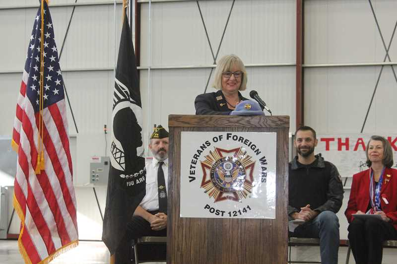 SUSAN MATHENY/MADRAS PIONEER - Guest speakers at the VFW tribute included Susan McKellar Forester, at podium, with VFW Commander Duane Ledford, from back left, and speakers David Jones adn Cheryl Bennet.
