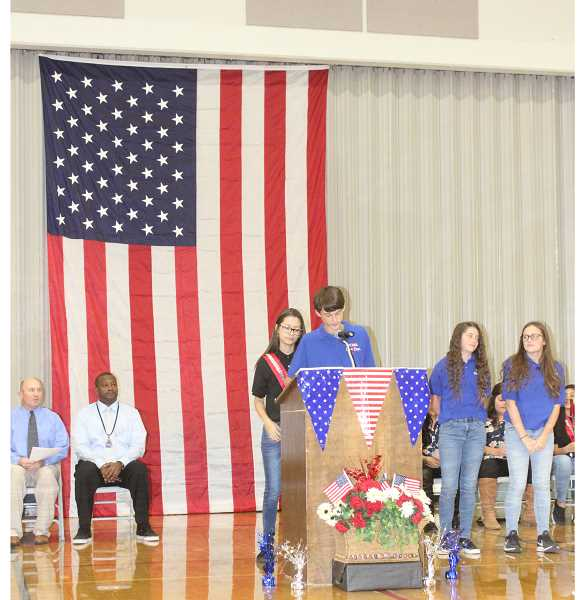 SUSAN MATHENY/MADRAS PIONEER - Students read their essays on what the flag means to them at the Jefferson County Middle School assembly, Nov. 9.