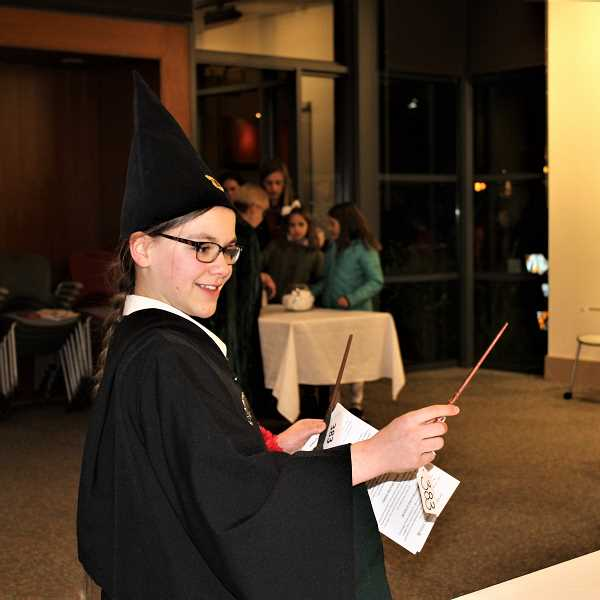 PHOTO COURTESY OF KALEIGH HENDERSON - Genevieve Rose picks out her wand during Harry Potter Night.
