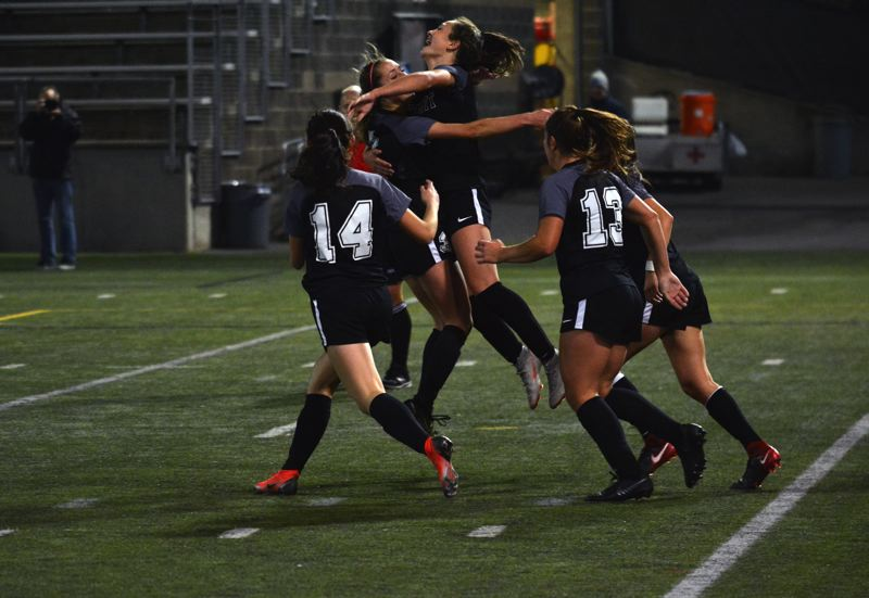 TIMES PHOTO: MATT SINGLEDECKER - Jesuit junior Callan Harrington and the  Jesuit girls soccer team trampled Clackamas 8-0 in the Class 6A state championship game on Saturday.