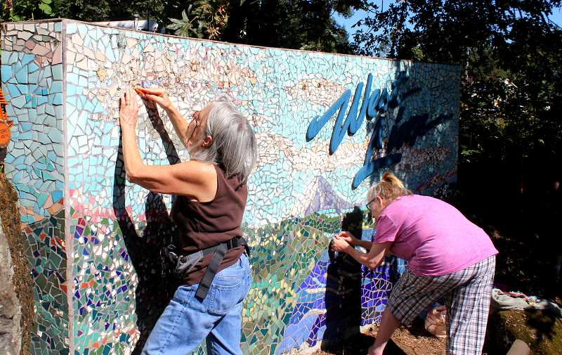 TIDINGS FILE PHOTO - A future Arts and Culture commission might oversee projects like this effort in July to restore an artist's West Linn mosaic sign.