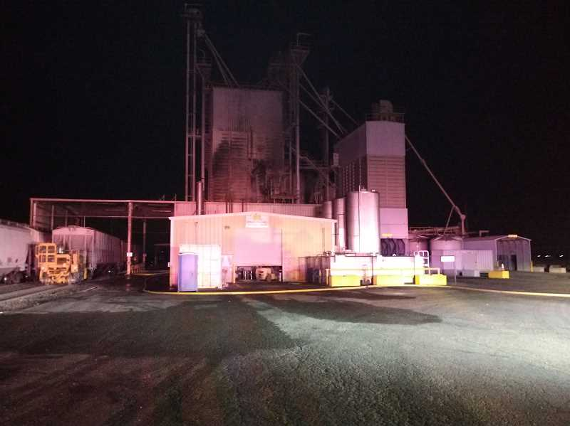 COURTESY PHOTO: AURORA FIRE DISTRICT - Firefighters responded to a three-alarm fire Wedenesday night at the Foster Farms feed mill on Ehlen Road between Aurora and Donald.
