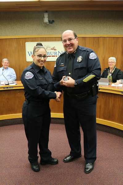COURTESY PHOTO: CITY OF WOODBURN - Woodburn Police Chief Jim Ferraris congratulates Tanya Virula after swearing her in as an officer Nov. 13.
