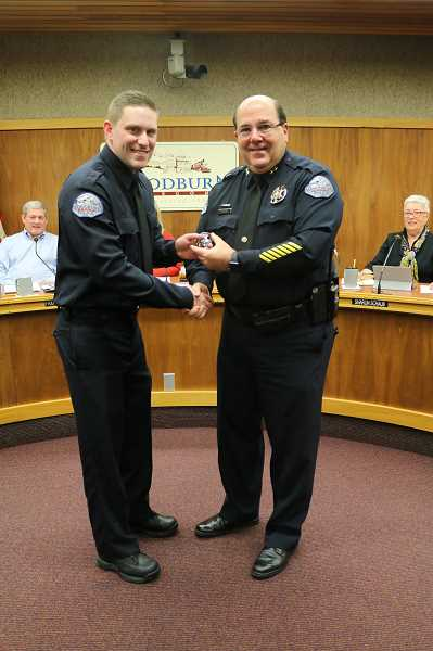 COURTESY PHOTO: CITY OF WOODBURN - Woodburn Police Chief Jim Ferraris (right) congratulates Jonathan Ellis after swearing him in as an officer Nov. 13.
