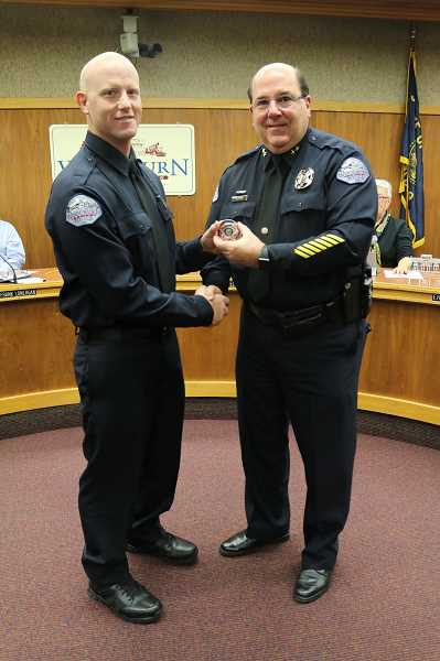 COURTESY PHOTO: CITY OF WOODBURN - Woodburn Police Chief Jim Ferraris (right) congratulates Ben Ward after swearing him in as an officer Nov. 13.