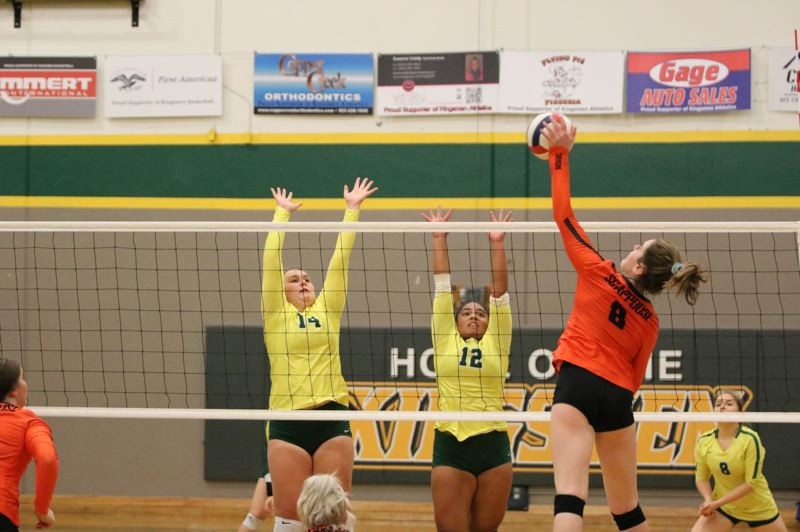 PAMPLIN MEDIA GROUP PHOTOS: JIM BESEDA - Junior outside hitter Darci DeTroy (right) blasts the ball past two Putnam blockers. She led Scappoose in kills and service aces this season.