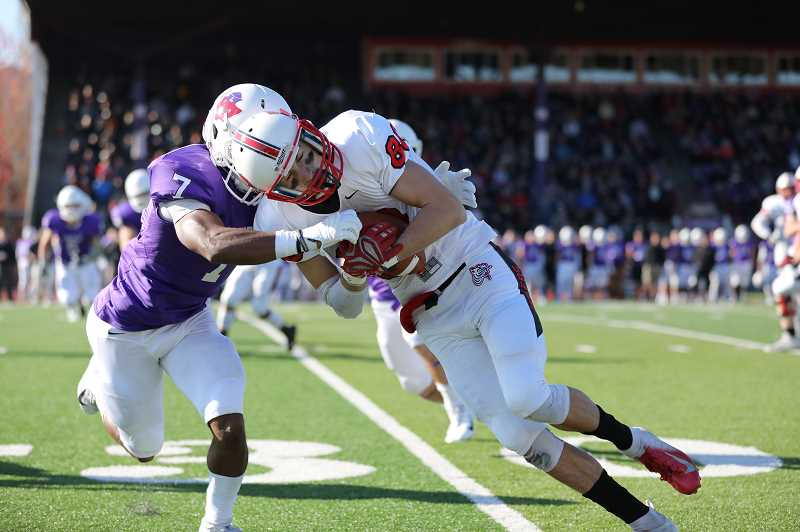COURTESY PHOTO: ELLIE PARKER - Pacific receiver Kyle Kern takes on a Linfield tackler during the Boxers' game against the Wildcats Saturday, Nov. 10, at Linfield College.