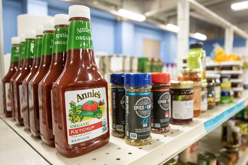 TIMES PHOTO: JON HOUSE - The shelves at the Tualatin School House Pantry are filled with loads of goodies similar to those you would find on grocery shelves.