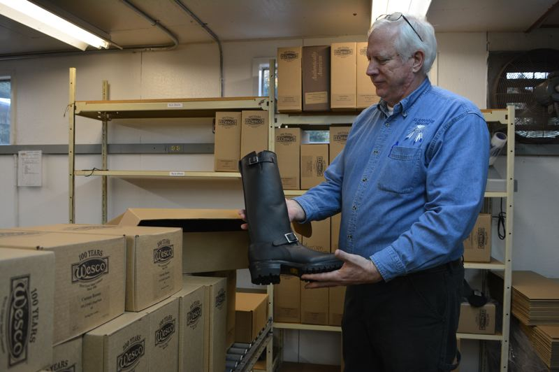 SPOTLIGHT PHOTO: COURTNEY VAUGHN - Bruce Shoemaker shows one of Wesco Boots signature models, The Boss, on its way to a customer. Wesco Boots has operated its factory in Scappoose since 1932.