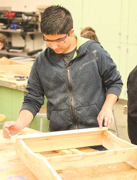 PHOTO COURTESY OF JIM CROUCH  - Henry Fonseca assembles his Adirondack chair in woodshop.