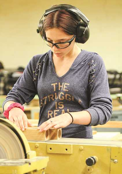PHOTO COURTESY OF JIM CROUCH  - Taylor Coverdale sands her project in shop class.