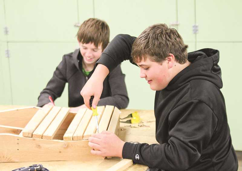 PHOTO COURTESY OF JIM CROUCH  - Michael Koch and Dustin Wilson work on their Adirondack chairs in eighth-grade woodshop.