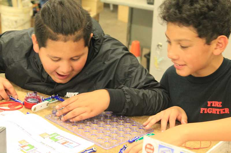 PHOTO COURTESY OF JIM CROUCH  - Michael Tello Cade and Franko Covarrubias learn about circuits in their seventh-grade engineering class.