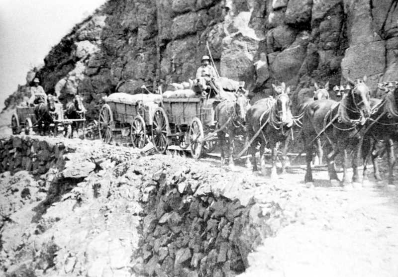 PHOTO COURTESY OF BOWMAN MUSEUM  - Traveling treacherous roads, like the Mecca Grade (above) to the Deschutes River, challenged early freighters.