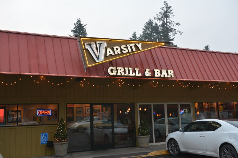 SPOTLIGHT PHOTO: COURTNEY VAUGHN - Scappoose police officers took a report of counterfeit money allegedly circulating through Varsity Bar & Grill in Scappoose. An investigation was launched to determine the source of the fake money.