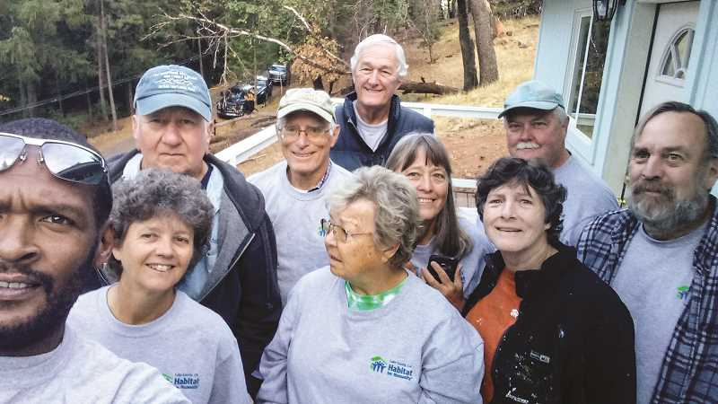 PHOTO SUBMITTED BY TOM HINKLE - Tom and Diane Hinkle joined three other couples to help complete houses that will replace ones burned down in the Clear Lake, California, area last October. Tom is fourth from the left and Diane is the woman wearing glasses in the foreground.