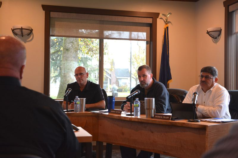 SPOTLIGHT PHOTO: COURTNEY VAUGHN - Port of Columbia County Commissioners Larry Ericksen, Robert Keyser and Patrick Trapp listen to input from industry experts during a meeting Wednesday, Nov. 14.