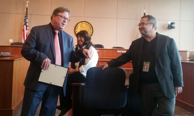 PHOTO BY RAYMOND RENDLEMAN - Don Krupp, Clackamas County's top manager (left), recognizes this month's retirement of Building Codes administrator Scott Caufield as Commissioner Martha Scrader looks on.