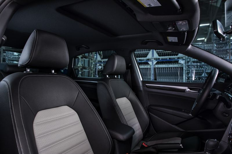 VOLKSWAGEN OF AMERICA - The leatherette front bucket seats look and feel as good as real leather, and help keep the cost of the 2018 VW Passat GT under $30,000.