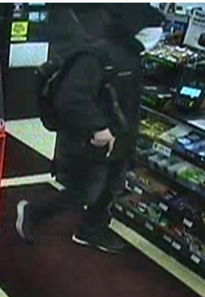 POLICE PHOTO - Beaverton Police say this man robbed a local 7-Eleven at gunpoint on Nov. 8.