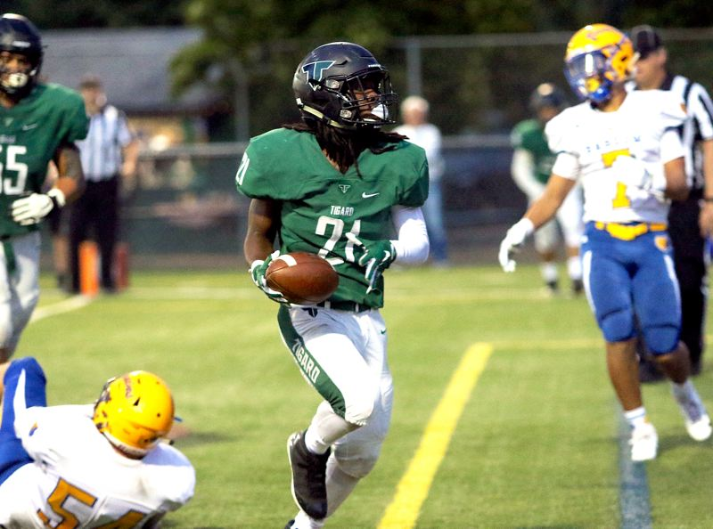 TIMES PHOTO: DAN BROOD - Tigard senior Malcolm Stockdale has rushed for nearly 2,000 yards and 35 touchdowns so far on the 2018 season.