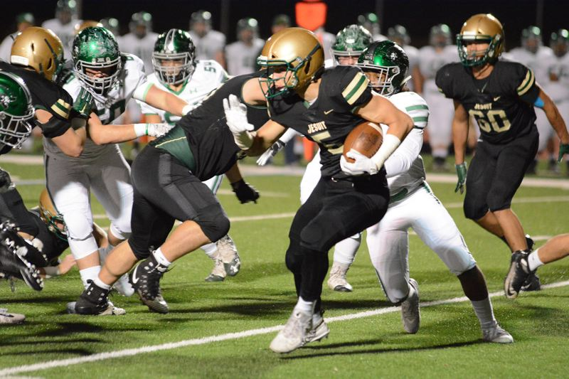 PAMPLIN MEDIA GROUP: DAVID BALL - Jesuit junior running back Andy Alfieri looks for running room during the Crusaders' second-round state playoff win over Reynolds.